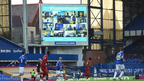 <p>               Everton fans are displayed on a large screen as the watch remotely the English Premier League soccer match between Everton and Liverpool at Goodison Park in Liverpool, England, Sunday, June 21, 2020. (Peter Powell/Pool via AP)             </p>