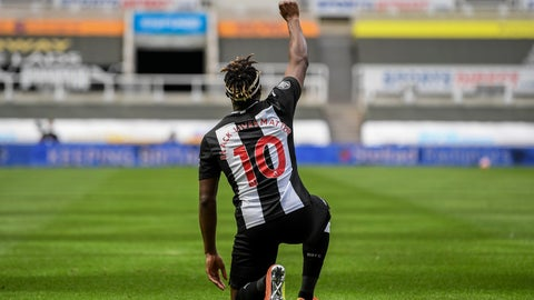 <p>               Newcastle's Allan Saint-Maximin takes a knee as he celebrates his goal during the English Premier League soccer match between Newcastle United and Sheffield United at St James' Park stadium in NewCastle, England, Sunday, June 21, 2020. (Michael Regan/Pool via AP)             </p>