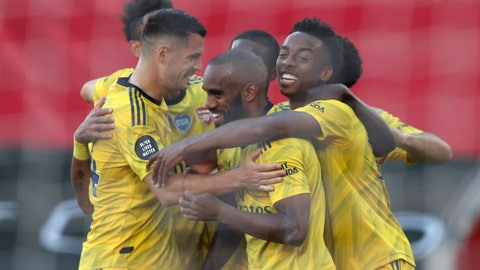 <p>               Arsenal's Joe Willock, right, celebrates with his teammates after scoring his side's second goal during the English Premier League soccer match between Southampton and Arsenal at St Mary's Stadium, in Southampton, England, Thursday, June 25, 2020. (Andrew Matthews/Pool via AP)             </p>
