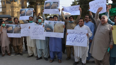 """<p>               Pakistani journalists rally to condemn the alleged arrests of their colleagues by authorities for reporting lack of facilities in quarantine center set up to contain the spread of coronavirus in border town of Chaman, Tuesday, June 23, 2020 in Quetta, Pakistan. Placard at bottom right reads , """"arrest responsible of torture on journalists."""" (AP Photo/Arshad Butt)             </p>"""