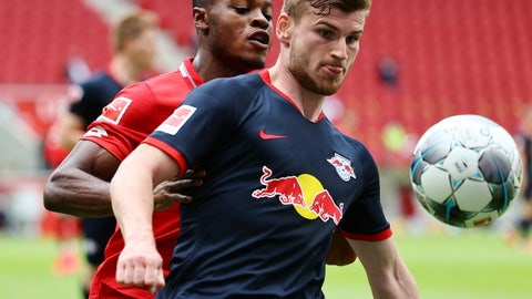 <p>               Timo Werner, right, of Leipzig in action against messenger Baku of Mainz during a German Bundesliga soccer match between FSV Mainz 05 and RB Leipzig in Mainz, Germany, Sunday, May 24, 2020.  (Kai Pfaffenbach/pool via AP)             </p>