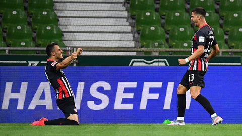 <p>               Frankfurt's Andre Silva, right, celebrates after he scores the opening goal during the German Bundesliga soccer match between SV Werder Bremen and Eintracht Frankfurt in Bremen, Germany, Wednesday, June 3, 2020.  Because of the coronavirus outbreak all soccer matches of the German Bundesliga take place without spectators. (Stuart Franklin/Pool via AP)             </p>