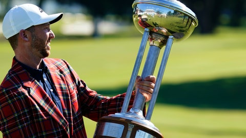 <p>               Daniel Berger poses with the championship trophy after winning the Charles Schwab Challenge golf tournament after a playoff round at the Colonial Country Club in Fort Worth, Texas, Sunday, June 14, 2020. (AP Photo/David J. Phillip)             </p>