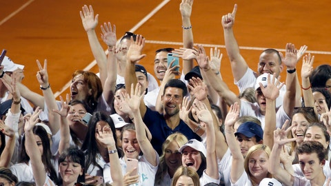 <p>               In this photo taken on Sunday, June 14, 2020, Serbia's Novak Djokovic, centre, poses with volunteers and players after the Adria Tour charity tournament in Belgrade, Serbia. Djokovic's charity tennis exhibition series combined with an overall softening of coronavirus restrictions in Serbia has led to a spike in the number the positive cases among professional athletes. Two tennis players ranked among the top 40 in the world and five players at Serbia's biggest soccer club have tested positive for the virus after being involved in sporting events where fans packed into the stands and social distancing was not enforced. (AP Photo/Darko Vojinovic)             </p>