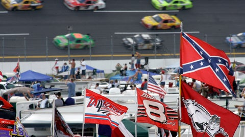 <p>               FILE - In this Oct. 7, 2007, file photo, a Confederate flag flies in the infield as cars come out of Turn 1 during a NASCAR auto race at Talladega Superspeedway in Talladega, Ala. NASCAR banned the Confederate flag from its races and venues Wednesday, June 10, 2020, formally severing itself from what for many is a symbol of slavery and racism.  (AP Photo/Rob Carr, File)             </p>