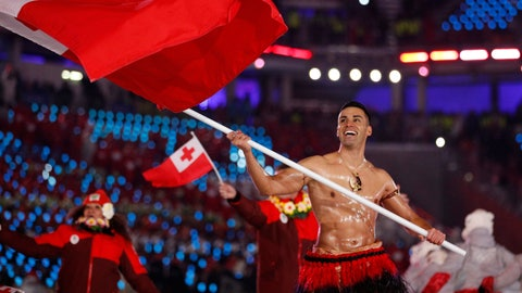 <p>               FILE - In this Feb. 9, 2018, file photo, Peta Taufatofua carries a flag of Tonga during the opening ceremony of the 2018 Winter Olympics in Pyeongchang, South Korea, Friday, Feb. 9, 2018. Taufatofua decided to leave his shirt on Tuesday, June 23, 2020 when he led a group of 23 fellow Olympians in a home workout video to help celebrate Olympic Day across 20 time zones. (AP Photo/Jae C. Hong, File)             </p>