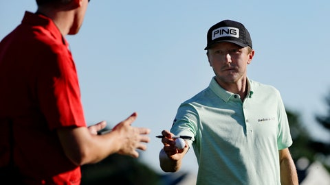 <p>               Mackenzie Hughes, right, of Canada, gives a signed ball to a volunteer after finishing the second round of the Travelers Championship golf tournament at TPC River Highlands, Friday, June 26, 2020, in Cromwell, Conn. (AP Photo/Frank Franklin II)             </p>