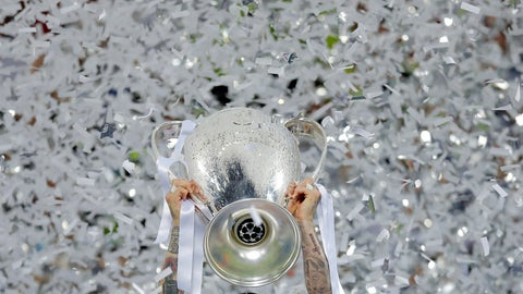 <p>               FILE - In this Saturday, May 28, 2016 file photo Real Madrid's Sergio Ramos celebrates with the trophy after the Champions League final soccer match between Real Madrid and Atletico Madrid at the San Siro stadium in Milan, Italy. In the absence of the Champions League final on Saturday, The Associated Press will take a look back at some of the greatest teams, players and matches in the history of the tournament. The AP will pick a topic for every letter of the alphabet to remember the greats of the game and the greatest games, going back to when the competition was called the European Cup and through its transformation into the Champions League. (AP Photo/Manu Fernandez, File)             </p>