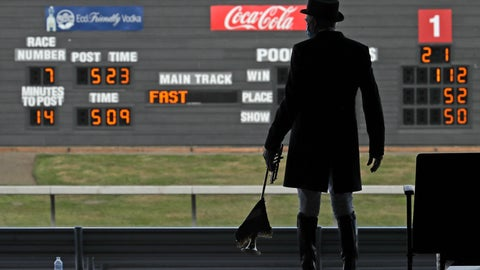 <p>               Track bugler Dan Harrington stands near empty seats Wednesday, June 24, 2020, before playing just before a race at Emerald Downs Racetrack in Auburn, Wash., on the first day of thoroughbred horse racing at the track since all professional sports in Washington state were curtailed in March by the outbreak of the coronavirus. No spectators were allowed, but online wagering was available and the races were streamed. Organizers hope to continue racing into October on a modified schedule. (AP Photo/Ted S. Warren)             </p>