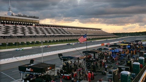 <p>               Racers speed down the front straight between the empty grandstand and their crews that are stationed along pit row as the sun goes down during a NASCAR Cup Series auto race at Pocono Raceway, Sunday, June 28, 2020, in Long Pond, Pa. (AP Photo/Matt Slocum)             </p>