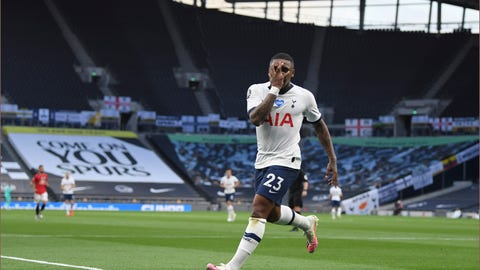 <p>               Tottenham's Steven Bergwijn celebrates after scoring the opening goal during the English Premier League soccer match between Tottenham Hotspur and Manchester United at Tottenham Hotspur Stadium in London, England, Friday, June 19, 2020. (AP Photo/Shaun Botterill, Pool)             </p>