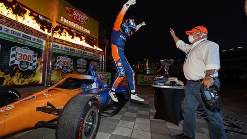 <p>               In this photo provided by Chris Owens/INDYCAR Series, Scott Dixon, left, jumps off his car toward team owner Chip Ganassi as the two celebrate Dixon's IndyCar auto race win at Texas Motor Speedway in Fort Worth, Texas, Saturday, June 6, 2020. (Chris Owens/INDYCAR Series via AP)             </p>