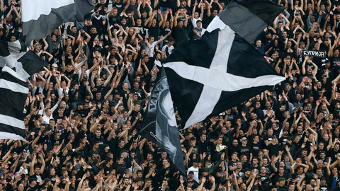 <p>               FILE - In this Wednesday, June 10, 2020 file photo, Partizan fans support their team prior a Serbian National Cup semifinal soccer match between Partizan and Red Star in Belgrade, Serbia. Serbia's president Aleksandar Vucic has cancelled his party's pre-election rallies and officials in Bosnia, Macedonia and Albania are appealing on citizens to respect protection measures after relaxation of rules against the new coronavirus led to a recent spike in cases in the Balkan countries. (AP Photo/Darko Vojinovic, File)             </p>