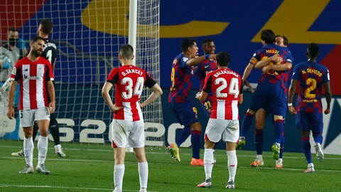 <p>               Barcelona's Ivan Rakitic, second right, celebrates with his teammate Lionel Messi after scoring the opening goal during the Spanish La Liga soccer match between FC Barcelona and Athletic Bilbao at the Camp Nou stadium in Barcelona, Spain, Tuesday, June 23, 2020. (AP Photo/Joan Monfort)             </p>