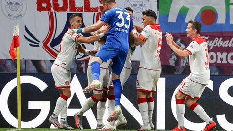 <p>               Duesseldorf's players celebrate after their side's second goal during the German Bundesliga soccer match between RB Leipzig and Fortuna Duesseldorf in Leipzig, Germany, Wednesday, June 17. 2020. Center are against Duesseldorf's Zanka and right Alfredo Morales. (Jan Woitas/Pool via AP)             </p>