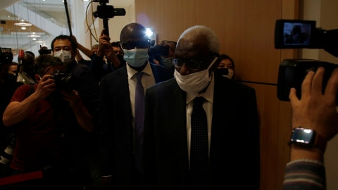 <p>               Former president of the IAAF (International Association of Athletics Federations) Lamine Diack, center, arrives at the Paris courthouse, Monday, June 8, 2020. A sweeping sports corruption trial opened Monday in Paris involving allegations of a massive doping cover-up that reached to the top of world track and field's governing body. Lamine Diack, 87, who served as president of the body for nearly 16 years, is among those accused of receiving money from Russian athletes to hide their suspected doping so they could compete at the Olympics in 2012 and other competitions. His son Papa Massata Diack is also charged in the case. (AP Photo/Thibault Camus)             </p>