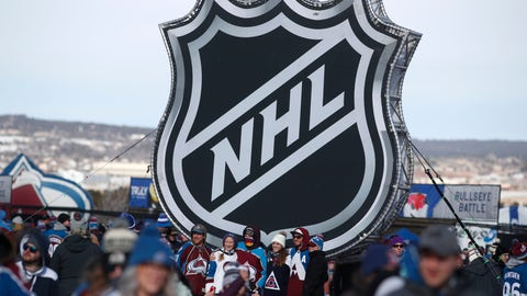 <p>               FILE - In this Feb. 15, 2020, file photo, fans pose below the NHL league logo at a display outside Falcon Stadium before an NHL Stadium Series outdoor hockey game between the Los Angeles Kings and Colorado Avalanche, at Air Force Academy, Colo. The uncertainty raised by coronavirus pandemic leads to experts providing a bleak short-term assessment on the NHL's financial bottom line, with some projecting revenues being cut by almost half. What's unclear is how large the impact might be until it can be determined when fans can resume attending games and if the league is able to complete this season. (AP Photo/David Zalubowski, File)             </p>