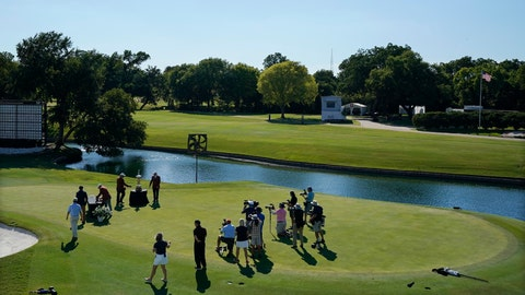 <p>               With no spectators in attendance, Daniel Berger is presented with the championship trophy in front of a small group of media after winning the Charles Schwab Challenge golf tournament after a playoff round at the Colonial Country Club in Fort Worth, Texas, Sunday, June 14, 2020. (AP Photo/David J. Phillip)             </p>