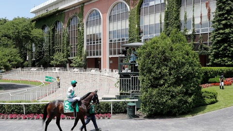 <p>               A horse and jockey make their way from the paddock to the track for a race before the 152nd running of the Belmont Stakes horse race in Elmont, N.Y., Saturday, June 20, 2020. Tiz the Law is the star of a 10-horse field for the Belmont Stakes, perhaps the biggest event in U.S. sports since the coronavirus pandemic shut down competition in mid-March. (AP Photo/Seth Wenig)             </p>