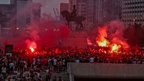 <p>               Liverpool soccer fans let off flares outside the Liver Building in Liverpool, England, Friday, June 26, 2020. Their team clinched the English Premier League title. Liverpool took the title after Manchester City failed to beat Chelsea on Wednesday evening. (Peter Byrne/PA via AP)             </p>
