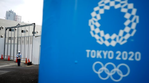 """<p>               FILE.- In this May 12, 2020, file photo, a lone security guard stands at one of the venues for the Tokyo 2020 Olympic Games in Tokyo. The head of the Tokyo Olympics on Friday, June 12, 2020, says that 80% of the facilities needed for next year's games have """"basic approval""""to be used. (AP Photo/Eugene Hoshiko, File)             </p>"""