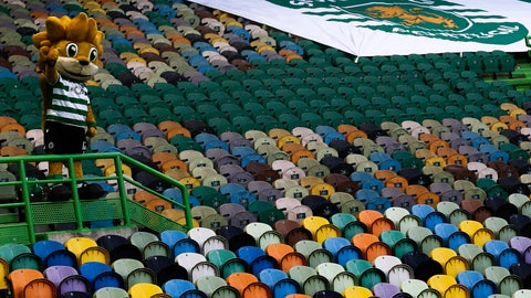 <p>               Sporting's mascot lion waves from the empty stands during the Portuguese League soccer match between Sporting CP and Pacos de Ferreira at the Jose Alvalade stadium in Lisbon, Portugal, Friday, June 12, 2020. The Portuguese League soccer matches are being played without spectators because of the coronavirus pandemic. (Antonio Cotrim/Pool via AP)             </p>