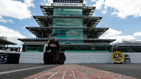 <p>               Eli Collins receives his Speedway High School diploma during a ceremony on the start/finish line at the Indianapolis Motor Speedway in Indianapolis, Saturday, May 30, 2020. The ceremony was held at the track to allow for social distancing requirements due to the COVID-19 pandemic. (AP Photo/Michael Conroy)             </p>