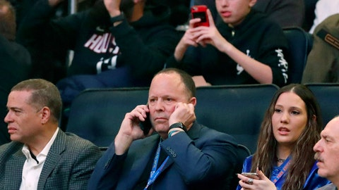 <p>               FILE - In this March 2, 2020, file photo, New York Knicks president Leon Rose, center, takes a phone call during the first quarter of an NBA basketball game against the Houston Rockets in New York. Rose didn't have much time to evaluate the Knicks after becoming team president in March. But with their season officially over, he can begin making changes after another losing season. (AP Photo/Kathy Willens, File)             </p>