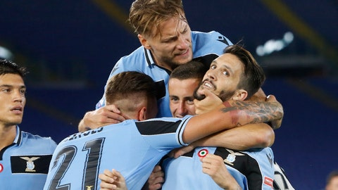 <p>               Lazio's Luis Alberto, right, celebrates with his teammates Sergej Milinkovic-Savic,Adam Marusic and Ciro Immobile, on top, after scoring his side's second goal during a Serie A soccer match between Lazio and Fiorentina at Rome's Olympic stadium, Saturday, June 27, 2020. (AP Photo/Riccardo de Luca)             </p>