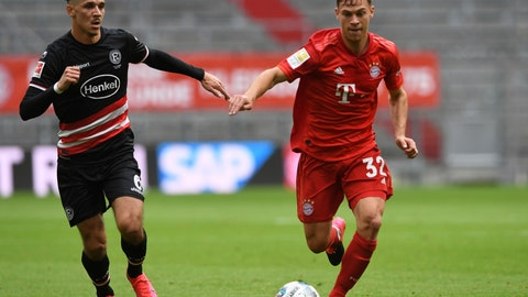 <p>               Duesseldorf's Alfredo Morales, left, and Bayern's Joshua Kimmich challenge for the ball during the German Bundesliga soccer match between FC Bayern Munich and Fortuna Duesseldorf in Munich, Germany, Saturday, May 30, 2020. Because of the coronavirus outbreak all soccer matches of the German Bundesliga take place without spectators. (Christof Stache/Pool via AP)             </p>