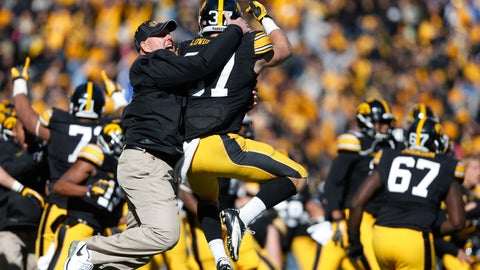 """<p>               FILE - In this Oct. 26, 2013, file photo, Iowa strength and conditioning coach Chris Doyle, front left, celebrates with defensive back John Lowdermilk (37) following their win in overtime against Northwestern in an NCAA college football game  in Iowa City, Iowa. Iowa football strength and conditioning coach Doyle has been placed on administrative leave after several black former players posted on social media about what they described as systemic racism in the program. Head coach Kirk Ferentz made the announcement Saturday, June 6, 2020, calling it """"a defining moment"""" for Iowa's football program in a video posted on the team's Twitter account. (AP Photo/Brian Ray, File )             </p>"""