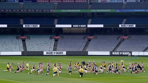 <p>               Australian Football League players from rivals Richmond and Collingwood teams, along with game officials, kneel before their game at the Melbourne Cricket Ground in Melbourne, Thursday, June 11, 2020, to show support for the Black Lives Matter movement. Aussie rules football is back after a three-month shutdown due to coronavirus restrictions. (Michael Dodge/AAP Image via AP)             </p>