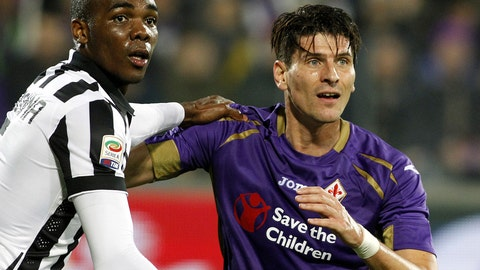 <p>               FILE - In a Friday Dec. 5 2014 file photo, Fiorentina's Mario Gómez and Juventu' Angelo Ogbonna hold each other during a Serie A soccer match at the Artemio Franchi stadium in Florence, Italy. Former Germany striker Mario Gómez has retired from soccer after scoring in his last game for Stuttgart. The soon-to-be 35-year-old says he has fulfilled his final wish – to help Stuttgart secure an immediate return to the Bundesliga after one season in the second division.(AP Photo/Fabrizio Giovannozzi, File)             </p>