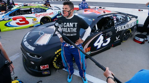 <p>               Driver Bubba Wallace is interviewed before a NASCAR Cup Series auto race Wednesday, June 10, 2020, in Martinsville, Va. (AP Photo/Steve Helber)             </p>