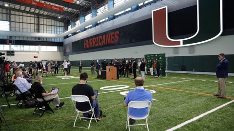 <p>               Florida Gov. Ron DeSantis speaks at the podium before signing a bill which would allow college athletes in the state to earn money from endorsement deals, Friday, June 12, 2020, at the University of Miami in Coral Gables, Fla. (AP Photo/Lynne Sladky)             </p>