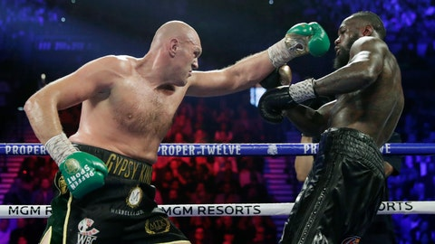 <p>               FILE - In this Feb. 22, 2020, file photo, Tyson Fury, left, of England, fights Deontay Wilder during a WBC heavyweight championship boxing match in Las Vegas. An all-British world heavyweight title showdown between Anthony Joshua and Tyson Fury in 2021 is a step closer. Fury said Wednesday, June 10, 2020, that an agreement has been reached with Joshua's camp on a two-fight deal between the current holders of the heavyweight belts.(AP Photo/Isaac Brekken, File)             </p>