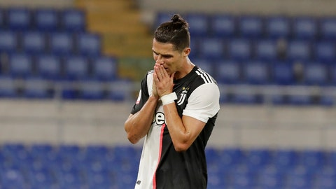 <p>               Juventus' Cristiano Ronaldo reacts after missing a scoring chance during the Italian Cup soccer final match between Napoli and Juventus, at Rome's Olympic Stadium, Wednesday, June 17, 2020. (AP Photo/Andrew Medichini)             </p>