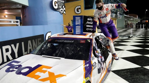<p>               Denny Hamlin jumps from his car after winning a NASCAR Cup Series auto race Sunday, June 14, 2020, in Homestead, Fla. (AP Photo/Wilfredo Lee)             </p>