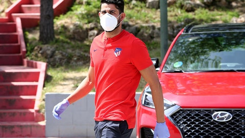 <p>               In this photo provided by Atletico Madrid, Diego Costa wearing a face mask and gloves attends the club's training ground in Madrid, Spain, on Wednesday May 6, 2020. Soccer players in Spain returned to their team's training camps Wednesday for the first time since the country entered a lockdown nearly two months ago because of the coronavirus pandemic. (Atletico Madrid via AP)             </p>