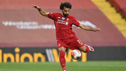 <p>               Liverpool's Mohamed Salah scores the second goal during the English Premier League soccer match between Liverpool and Crystal Palace at Anfield Stadium in Liverpool, England, Wednesday, June 24, 2020. (Paul Ellis/Pool via AP)             </p>