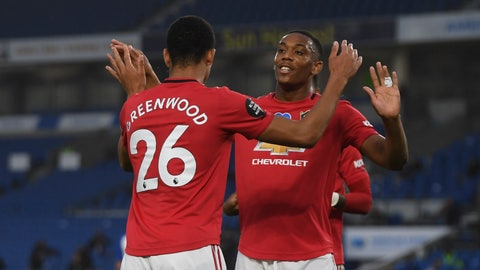 <p>               Manchester United players celebrate the opening goal of their team during the English Premier League soccer match between Brighton & Hove Albion and Manchester United at the AMEX Stadium in Brighton, England, Tuesday, June 30, 2020. (Mike Hewitt/Pool via AP)             </p>