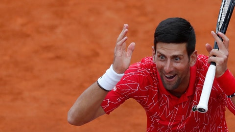 <p>               In this Friday, June 12, 2020 photo Serbia's Novak Djokovic reacts during a tennis doubles match at a charity tournament Adria Tour, in Belgrade, Serbia. Novak Djokovic has tested positive for the coronavirus after taking part in a tennis exhibition series he organized in Serbia and Croatia. The top-ranked Serb is the fourth player to test positive for the virus after first playing in Belgrade and then again last weekend in Zadar, Croatia. His wife also tested positive. (AP Photo/Darko Vojinovic)             </p>