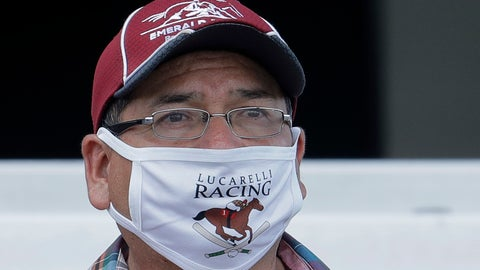 <p>               Salvador Hernandez, a groom at Emerald Downs Racetrack in Auburn, Wash., wears a mask as he watches a race Wednesday, June 24, 2020, on the first day of thoroughbred horse racing at the track since all professional sports in Washington state were curtailed in March by the outbreak of the coronavirus. No spectators were allowed, but online wagering was available and the races were streamed. Organizers hope to continue racing into October on a modified schedule. (AP Photo/Ted S. Warren)             </p>