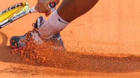 <p>               FILE- In this Monday, May 25, 2009, image, Spain's Rafael Nadal slides in the clay as he returns the ball to Brazil's Marcos Daniel during a first round match at the Roland Garros stadium in Paris.  Sliding is one of the keys to success at the French Open, with the ability to glide along the ground to reach shots that others can't, is one of the skills that makes Rafael Nadal so successful on clay courts, although the start of the French Open postponed until September because of the coronavirus. (AP Photo/Christophe Ena, File)             </p>