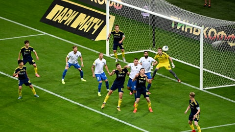 <p>               FC Sochi players, in white shirt, try to score against Rostov during a Russia Soccer Premier League soccer match against FC Rostov as the league was resumed after a three-month hiatus because of the coronavirus pandemic in Sochi, Russia, Friday, June 19, 2020. Rostov fielded a team of teenagers because its entire first-team squad is in isolation following a suspected outbreak of coronavirus. The match is being played with a minimum spectators to curb the spread of COVID-19. (AP Photo)             </p>