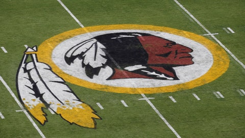"""<p>               FILE - In this Aug. 7, 2014 file photo, the Washington Redskins NFL football team logo is seen on the field before an NFL football preseason game against the New England Patriots in Landover, Md. The recent national conversation about racism has renewed calls for the Washington Redskins to change their name. D.C. mayor Muriel Bowser called the name an """"obstacle"""" to the team building its stadium and headquarters in the District, but owner Dan Snyder over the years has shown no indications he'd consider it. (AP Photo/Alex Brandon, File)             </p>"""