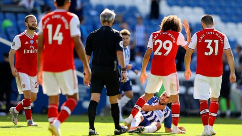<p>               Arsenal's Matteo Guendouzi, 2nd right, gestures at Brighton's Neal Maupay, on the ground, during an argument at the end of during the English Premier League soccer match between Brighton & Hove Albion and Arsenal at the AMEX Stadium in Brighton, England, Saturday, June 20, 2020. (Richard Heathcote/Pool via AP)             </p>