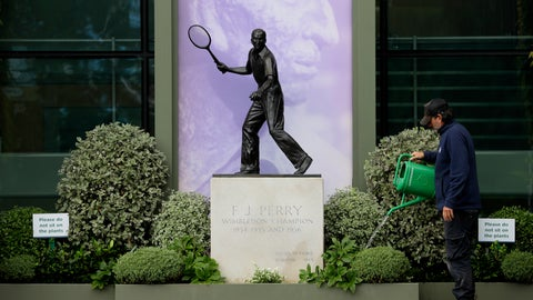 <p>               A gardener waters the plants alongside a statue of former Wimbledon Champion Fred Perry at the All England Lawn Tennis Club in Wimbledon in London, Monday, June 29, 2020.  The 2020 Wimbledon Tennis Championships, that were due to start today but have been cancelled due to the Coronavirus pandemic. (AP Photo/Kirsty Wigglesworth)             </p>