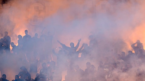 <p>               FILE - In this Thursday, May 23, 2019 file photo, Partizan Belgrade fans light flares and smoke bombs as they cheer on their team on during the Serbian Cup Final soccer fixture against Red Star Belgrade in Belgrade, Serbia. Red Star Belgrade can host the biggest crowd for a game in Europe since soccer's shutdown in the pandemic ended last month when the Serbian title winner completes its season on June 20, 2020. Another big crowd is expected Wednesday June 10, 2020 in a passionate atmosphere now rarely seen in Europe. Partizan hosts city rival Red Star in the domestic cup semi-finals at its 30,000-capacity home. (AP Photo/Marko Drobnjakovic, File)             </p>