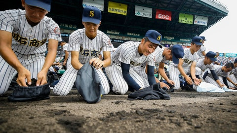 <p>               Akashi Commercial High School baseball players collect dirt of the grounds after being defeated by Riseisha High School during a semifinal game at the National High School Baseball Championship at Koshien Stadium in Nishinomiya, western Japan, on Aug. 20, 2019. Every year, after a team loses, the players, many weeping uncontrollably, scrape the dirt from foul territory near the dugout to take home as a memento. Japanese high school baseball players who had their heart set on going to the annual tournament won't be able to go, with the 2020 event canceled over the coronavirus pandemic. (Kyodo News via AP)             </p>